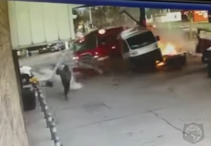 WATCH: Lincoln Navigator Driver T-Bones A Fire Engine Sending It Through A Gas Station! - Who Is At Fault?