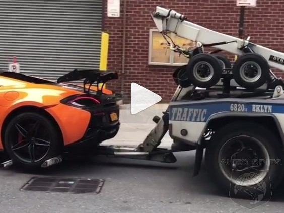 OUCH: Proof That Even If You Street Park Your McLaren 570S The NYPD Has NO Problem Towing It Like ANY Other Car